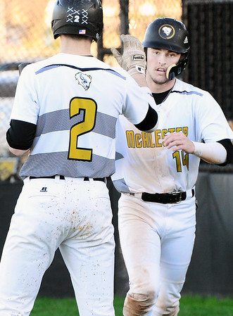 Kevin Harvison | Staff photo<br /> McAlester Buffalo center fielder Brandon Rutledge, right, gets congratulated by Buff third baseman Noah Cook during varsity action against the Ada Cougars Thursday at Mike Deak Field.