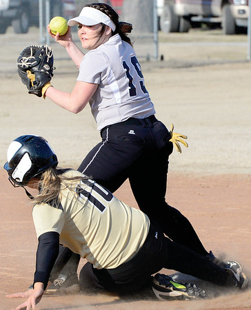 Kevin Harvison | Staff photo<br /> McAlester Lady Buffalo attempts to turn two against Broken Bow Thursday at the Pittsburg County Softball Complex.