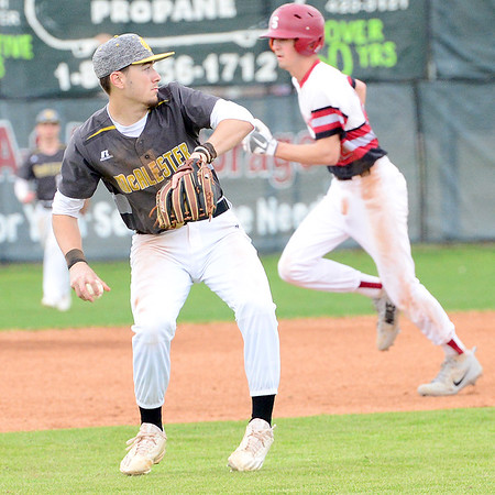 Kevin Harvison | Staff photo<br /> McAlester Buffalo third baseman makes a play during a home win against Spiro Saturday at Mike Deak Field.