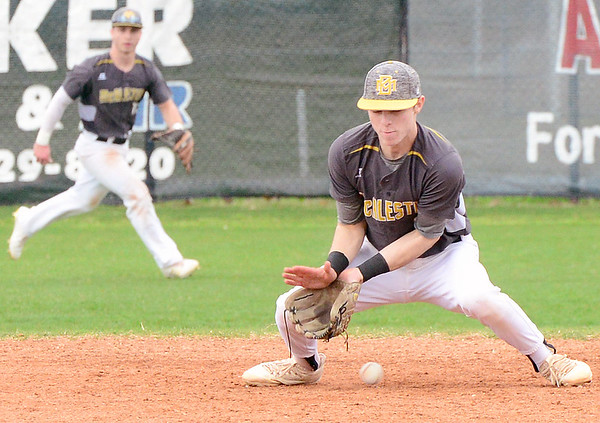 Kevin Harvison | Staff photo<br /> McAlester Buffalo shortstop attempts to make a play on the ball during a home win against Spiro Saturday at Mike Deak Field.