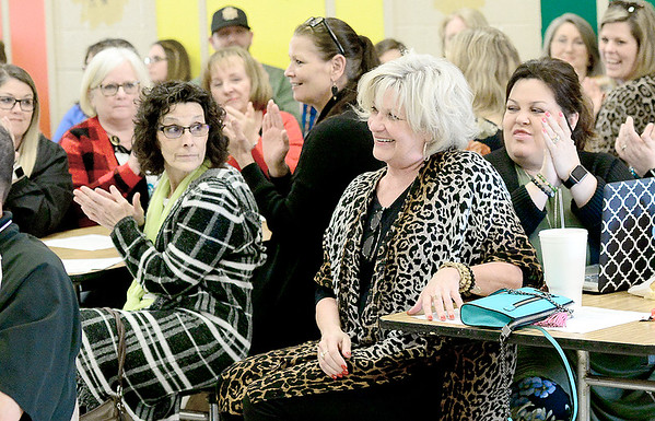 Kevin Harvison | Staff photo<br /> Long time McAlester Public Schools employee Debbie Watkins reacts as MPS Superintendant Randy Hughes aknowledges her retirement during Monday nights MPS School Board meeting at William Gay Elementary School.