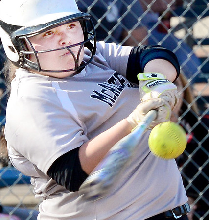 Kevin Harvison | Staff photo McAlester Lady Buffalo batter gets a base hit against Broken Bow Thursday at the Pittsburg County Softball Complex.