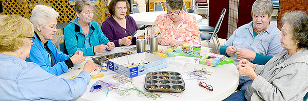 Kevin Harvison | Staff photo<br /> The women of All Saints Episcopal Church are busy making bookmark favors to go along with their decorating theme, Spring Joy, in preparation for the 46th Annual Ladies Holy Week Salad Luncheon, which will be held at the McAlester Scottish Rite Masonic Temple March 29.