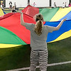 KEVIN HARVISON | Staff photo<br /> A group of McAlester students enjoy a game of Parachute at the indoor football facility recently.