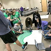 KEVIN HARVISON | Staff photo<br /> A group of students work on coding before taking the rover out to the challenge portion of the competition Wednesday at the Lucy Smith building in McAlester.