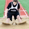 "KEVIN HARVISON | Staff photo<br /> McAlester 7th grade long jumper Nathan Jones completes a 12'1"" jump Thursday during the Glen Stone Relay event at Hook Eales Stadium."