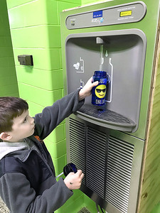 KEVIN HARVISON | Staff photo Emerson Elementary student Matthew Morgan fills his water bottle up with an automatic water fountain. The school has three fountains. The fountain uses hands-free sensors to turn the water flow on and off, cutting down on the spread of germs and saving the disposal of plastic water bottles in the landfill. In the short period of time the new fountains have been installed, this fountain has limited the disposal of 327 plastic water bottles into the trash.