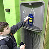 KEVIN HARVISON | Staff photo<br /> Emerson Elementary student Matthew Morgan fills his water bottle up with an automatic water fountain. The school has three fountains. The fountain uses hands-free sensors to turn the water flow on and off, cutting down on the spread of germs and saving the disposal of plastic water bottles in the landfill. In the short period of time the new fountains have been installed, this fountain has limited the disposal of 327 plastic water bottles into the trash.