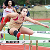 KEVIN HARVISON | Staff photo<br /> A member of the McAlester High School girls track team competes in the 100 meter hurdles Thrusday during the Glen Stone Relay event at Hook Eales Stadium.
