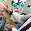 KEVIN HARVISON | Staff photo<br /> Pictured left, Stroud Holt receives ashes from Father John Norvell, right at the All Saints Episcopal Church Wednesday as Wayne Hanway, center looks on.