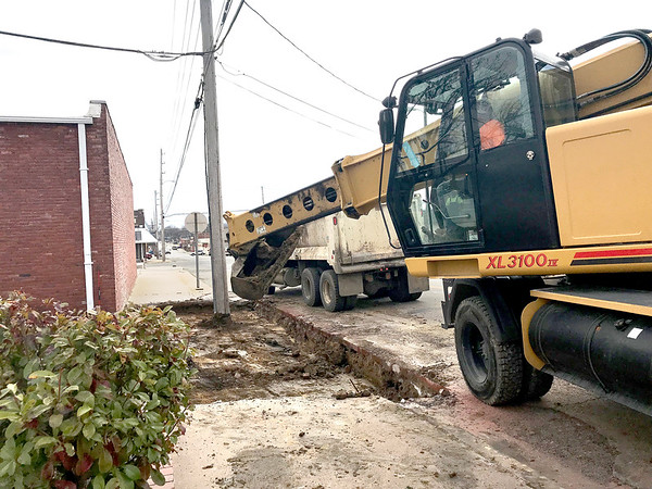 KEVIN HARVISON | Staff photo<br /> Construction has begun on the Arvest Park as crews tear up concrete in the alley bewteen Chickasaw Avenue and Cherokee Avenue and a portion of the sidewalk there on the east side of Second Street.