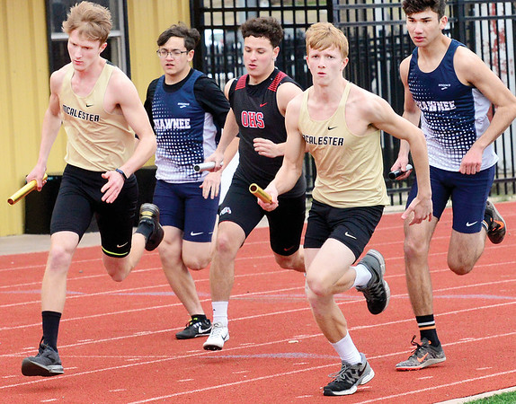 KEVIN HARVISON   Staff photo<br /> Members of the McAlester High School 2 mile relay teams start the first leg of the race during the Glen Stone Relay event at Hook Eales Stadium Thursday.