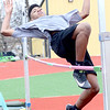KEVIN HARVISON | Staff photo<br /> McAlester 7th grade high jumper Eli Chapman clears the bar during action at the Glen Stone Relay event Thursday at Mike Deak Field.