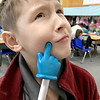 "KEVIN HARVISON | Staff photo<br /> Emerson Elementary student, Korbin Warner uses the pointer stick as a ""thinking stick,"" before making his choice on a board problem."