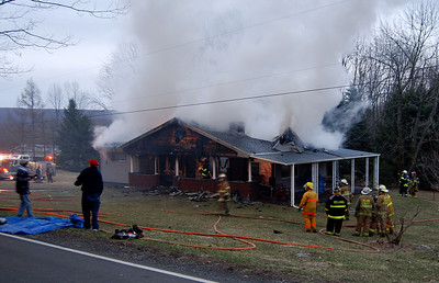 Heavy smoke pours from a home at 142 E. Main St. in Quakake early Monday morning.  PHOTO FROM FRANK ANDRUSCAVAGE