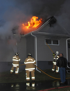 Firefighters battle flames at a home at 142 E. Main St. in Quakake just before dawn Monday. PHOTO FROM FRANK ANDRUSCAVAGE
