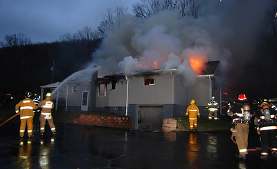 Firefighters battle flames coming from a home at 142 E. Main St. in Quakake early Monday morning. PHOTO FROM FRANK ANDRUSCAVAGE