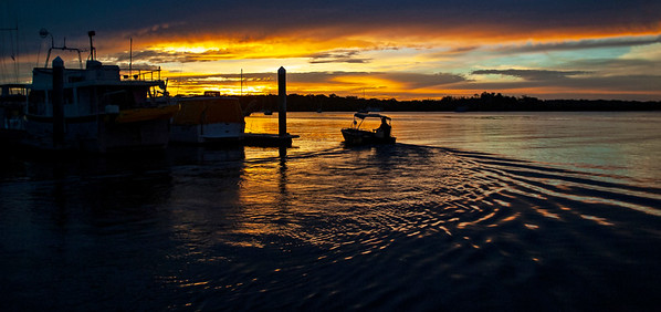 Vibrant Golden colored dramatic cloudy Marina/dock Sunset.