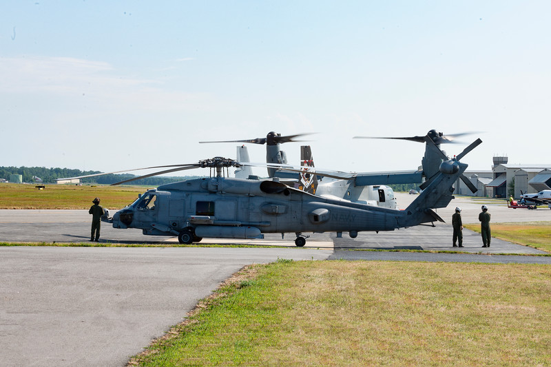 Went past the helo so the Osprey pilot stopped and backed it up as fast and easily as if it were a car !!