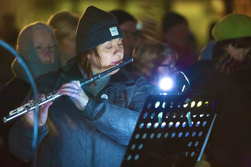 EEjob 01/05/2018 SOCIAL  Outside Easter Sunday Mass at The Lough at dawn.  Pictured, Aodaien Delaney playing the flute during the outside Easter Sunday Mass at the Lough pre-dawn.  Picture: Andy Jay