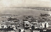 ALGERIA - ALGIERS - the view across the harbour, with a large loading gantry on the right, probably for ore, and steamers at the quays in the foreground. Posted April 10th, 1937.