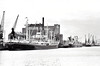 BARRY, Glamorgan - By the time this picture was taken, the export of coal had largely declined from Welsh ports. The ship on the left, FINNAMORE VALLEY (GBR/14610/61) was so named until 1971, thus placing this picture in the 1960's. I'm sure it looks nothing like this today.