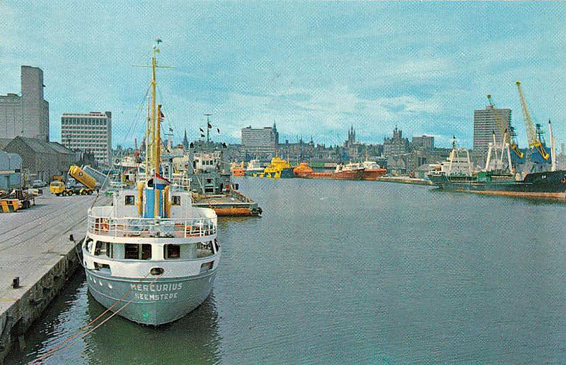 ABERDEEN, Scotland - A view of the docks in the 1980's, with oil rig supply vessels dominating. The MERCURIUS on the left, tied up at the Blue Circle Cement Quay, was converted to a bulk cement carrier in 1974 and scrapped in 1988.