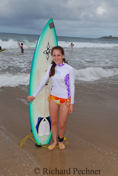 Sofi Pechner with short board Flemming's Beach