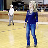 Kevin Harvison | Staff photo<br /> Ladies move to the music at St. John's Catholic Church during  a Line Dance Excersise class that takes place 9:30 to 11 a.m. at the church on Tuesdays. The class is open to the public everyone is welcomed.