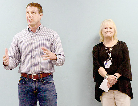 Kevin Harvison | Staff photo<br /> At left, U.S. Congressman Markwayne Mullin speaks at the Caring Hands Healthcare Centers open house and ribbon cutting ceremony Thursday afternoon as Sharon Hall, CEO of CHHC.