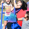 Kevin Harvison | Staff photo<br /> Silah Bear, right, pushes the spinning ride at Chadick Park as Jasmine Kelton and Alysin Duncan enjoy the ride.