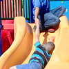Kevin Harvison | Staff photo<br /> Daniel Thomas, top, gives a helping hand to his friend Kayden Osborne as the two enjoy the slide at Chadick Park.