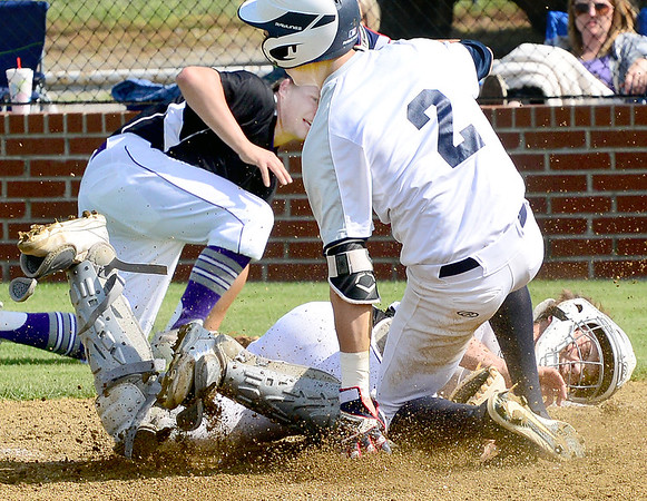 Kevin Harvison | Staff photo<br /> Hartshorne Miner base runner collides with the Wilburton Digger catcher during a play at the plate in District Playoff action Thursday in Hartshorne.