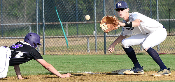 Kevin Harvison | Staff photo<br /> Hartshorne Miner first baseman Blake Lindley prepares to catch the ball on a pick off attempt against the Wilburton Diggers in District Playoff action Thursday in Hartshorne.