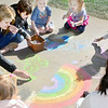 Kevin Harvison | Staff photo<br /> A group of Washington Early Childhood Center students and teachers enjoy some sidewalk art during recess.