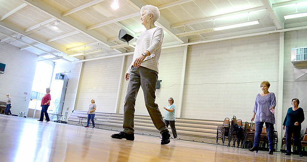 Kevin Harvison | Staff photo<br /> Ladies move to the music at St. John's Catholic Church during  a Line Dance Excersise class that takes place 9:30 to 11 a.m. at the church on Tuesdays. The class is open to the public.