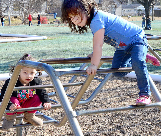 Kevin Harvison | Staff photo<br /> Pictured from left, Aliyah Caywood and Paisleigh Taylor, Washington Early Childhood Center students use their recess to get some climb time in on the payground equipment.
