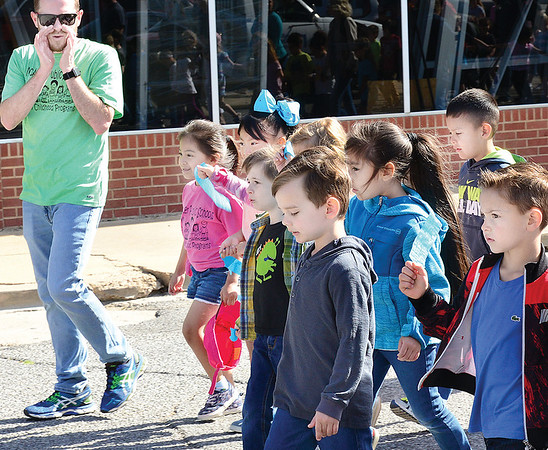 Kevin Harvison | Staff photo<br /> Jefferson Early Childhood Center teacher, William Higgins speaks to students during the Parade of the Young Child that took place Wednesday down Choctaw Avenue.