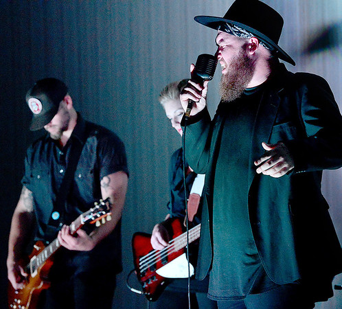 Kevin Harvison | Staff photo<br /> Headliner for the McAlester Regional Health Center Foundation Nigh Out For The Nurses event Trevor McBane, right, belts out a song Thursday night at the Southeast Expo Center.