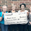 Staffphoto by Adrian O'Hanlon III | <br /> Members of the McAlester Modern Woodmen of America recently helped raise money for the Hope House. A Luncheon on March 2 raised $10,159 this includes $2,500 matched by the Modern Woodmen's home office through the organization's Matching Fund program. The money will be used for food, shelter and safety for homeless mothers and children. Pictured from left, Ann Owens, Jimmy Lee, Barbara Lee, Betty Balkman, Regan Glinton, Millie Maxwell, Kami Timmons and Helen Peters.