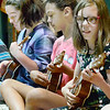 Kevin Harvison | Staff photo<br /> Sounding good together are three of the Emerson ukulele class as the group performs during the schools talent show.