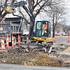 Kevin Harvison | Staff photo<br /> McAlester city workers continue to work at the corner of Comanche Avenue and Thrid Street in McAlester.