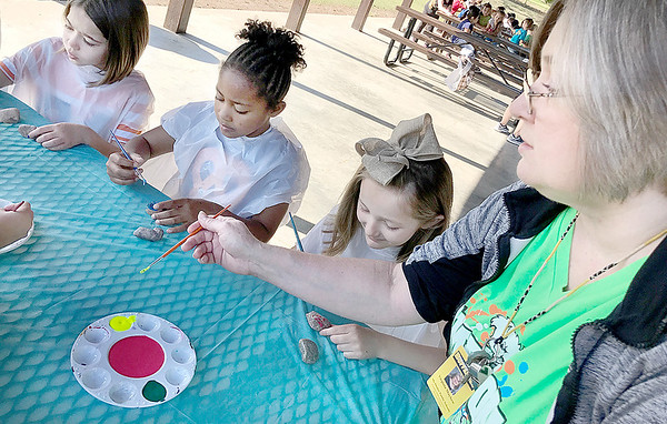 Kevin Harvison | Staff photo<br /> Pictured right, Emerson Elementary School First Grade Teacher Virginia Mayhew helps instruct students during a recent project.