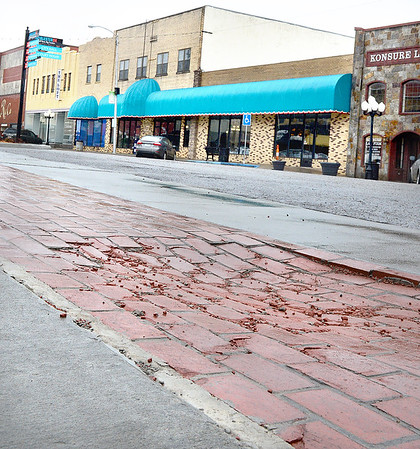 Kevin Harvison | Staff photo<br /> The new sidewalk at First Street and Choctaw Avenue is sinking.