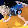 Kevin Harvison | Staff photo<br /> Jorja McElhaney makes a funny face while she goes up and over the Washington Early Childhood Center playground slide.