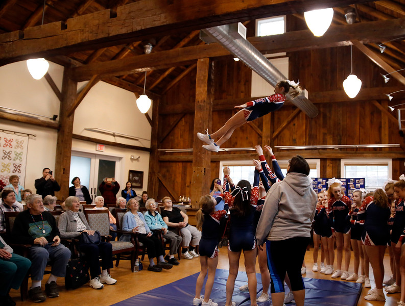 HOLLY PELCZYNSKI - BENNINGTON BANNER Ava Vickers flies high at  the top of a cheer pyramid on Friday as she preforms with her teammates with The MAYCA Studio, LLC in Bennington The team made a visit to the residents at the Project for Independence, on Friday afternoon in Bennington.