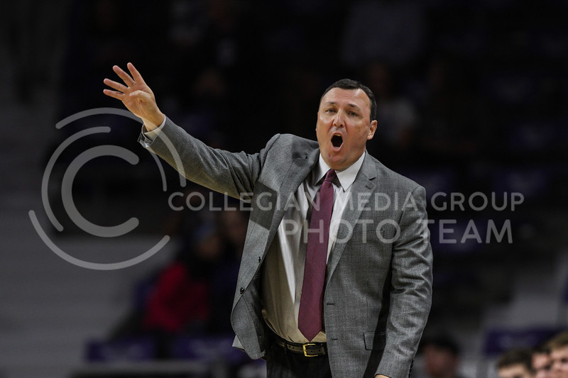 MANHATTAN, KANSAS - OCTOBER 29: Fort Hays State head coach Mark Johnson motivates his team during the men's basketball game between Fort Hays State University and Kansas State University at Bramlage Coliseum on October 29, 2017. (Photo by Cooper Kinley | K-State Athletics)