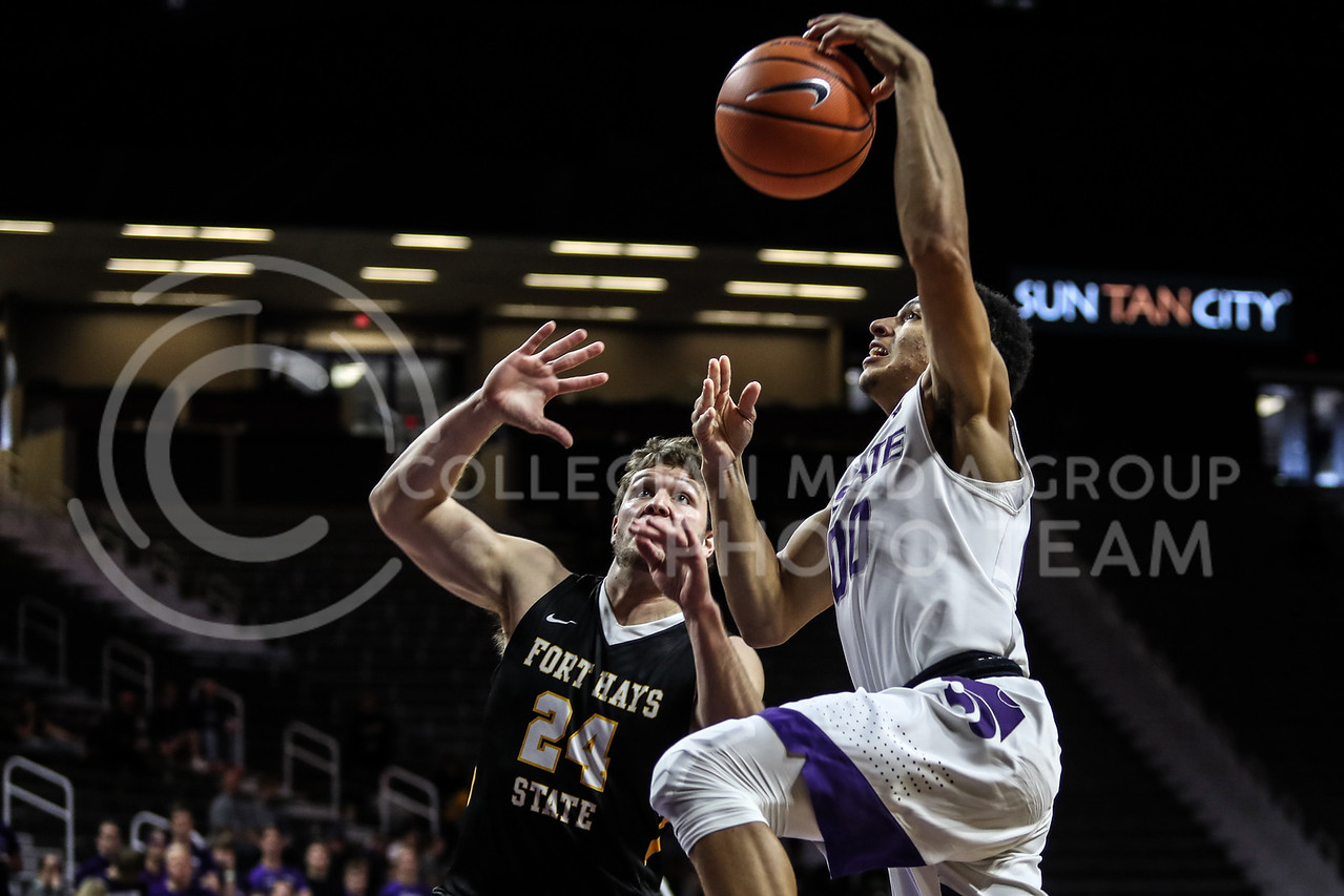 MANHATTAN, KANSAS - OCTOBER 29: Kansas State #00 Mike McGuirl guards the ball from Fort Hays #11 Marcus Cooper basketball game between Fort Hays State University and Kansas State University at Bramlage Coliseum on October 29, 2017. (Photo by Cooper Kinley | K-State Athletics)