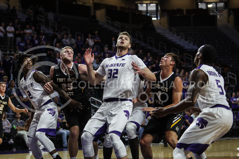 MANHATTAN, KANSAS - OCTOBER 29: Members of Kansas State's and Fort Hays's teams attempt to rebound the ball during the men's basketball game between Fort Hays State University and Kansas State University at Bramlage Coliseum on October 29, 2017. (Photo by Cooper Kinley | K-State Athletics)