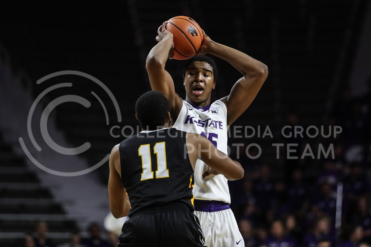 MANHATTAN, KANSAS - OCTOBER 29: Kansas State #45 Nigel Shadd guards the ball from Fort Hays #11 Marcus Cooper basketball game between Fort Hays State University and Kansas State University at Bramlage Coliseum on October 29, 2017. (Photo by Cooper Kinley | K-State Athletics)